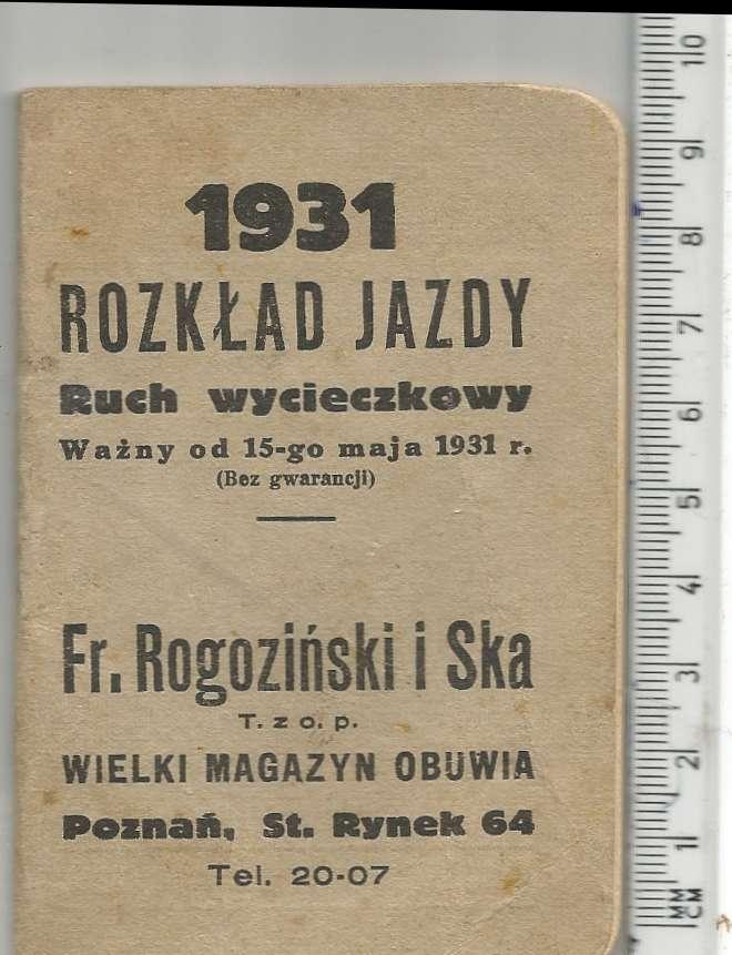 Broszurowy rozkład jazdy, obok linijka  dla pokazania rozmiarów
